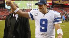 Dallas Cowboys quarterback Tony Romo flashes a thumbs-up as he walks off the field (Evan Vucci/The Associated Press)