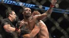 American Jon Jones (centre) reacts as the referee calls the end to his fight against Sweden's Alexander Gustafsson as he sucesssfully defends his World Light Heavyweight Championship bout during UFC 165 in Toronto on Saturday September 21, 2013. (CHRIS YOUNG/THE CANADIAN PRESS)