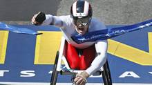 Joshua R. Cassidy, of Canada, pumps his fist and yells as he crosses the finish line to win the men's wheelchair division of the 116th Boston Marathon. (Charles Krupa/The Associated Press/Charles Krupa/The Associated Press)