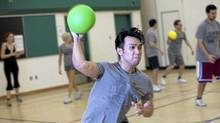 Francis Manapul competes in a Toronto Sport and Social club dodgeball game at St. Luke Catholic School's gymnasium on Sunday, May 29, 2011. (Matthew Sherwood/Matthew Sherwood for The Globe and Mail)