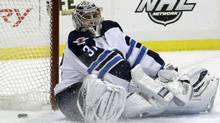 Winnipeg Jets goalie Ondrej Pavelec was shelled in Pittsburgh Feb. 11, 2012. (Gene J. Puskar/The Associated Press/Gene J. Puskar/The Associated Press)
