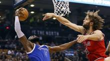 Chicago Bulls center Robin Lopez (8) defends against Toronto Raptors forward DeMarre Carroll (5) during the first half at the Air Canada Centre on March 21, 2017. (John E. Sokolowski/USA Today Sports)