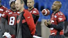 Calgary Stampeders quarterback Kevin Glenn, running back Jon Cornish and Nik Lewis listen to offensive coordinator Dave Dickenson during practice ahead of the 100th Grey Cup CFL football game in Toronto, November 24, 2012. The Grey Cup between the Toronto Argonauts and the Calgary Stampeders will be played on November 25. (MIKE CASSESE/REUTERS)