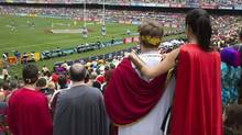 Rugby fans in Roman costumes watch a rugby match from the spectators' stand during the second day of the three-day Hong Kong Sevens rugby tournament March 23, 2013. The annual three-day international sporting event attracts fans from around the world, creating a carnival atmosphere. (TYRONE SIU/REUTERS)