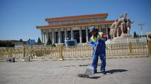 A cleaner sweeps ground in front of the mausoleum of Mao Zedong at Tiananmen Square in Beijing on Monday, which was the 50th anniversary of the start of the Cultural Revolution. (KIM KYUNG-HOON/REUTERS)