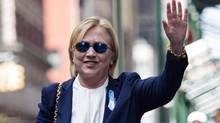 This file photo taken on September 11, 2016 shows US Democratic presidential nominee Hillary Clinton waving to the press as she leaves her daughter's apartment building after resting on September 11, 2016 in New York. (BRENDAN SMIALOWSKI/AFP/Getty Images)