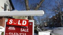 A 'sold' sign sits outside a Toronto home in this file photo. (Fred Lum/Fred Lum/The Globe and Mail)