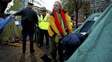 Police move into St. James Park on Wednesday to evict Occupy Toronto protesters. (Kevin Van Paassen/The Globe and Mail/Kevin Van Paassen/The Globe and Mail)