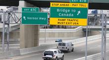 Signs showing the way to the bridge to Canada on a highway leading to the Ambassador Bridge in Detroit, March 21, 2013.(Deborah Baic/The Globe and Mail) (Deborah Baic/The Globe and Mail)
