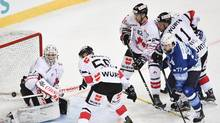 Minsk's Alexander Kitarov, right, fights for the puck with Team Canada's goalkeeper Drew Macintyre, Maxim Noreau, Shaone Morrisonn, and Gregory Campbell, from left, during the game between Dinamo Minsk and Team Canada, at the 90th Spengler Cup hockey tournament in Davos, Switzerland, Monday, Dec. 26, 2016. (Gian Ehrenzeller/AP)