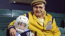 Toronto Ophthalmologist Dr. Tom Pashby invented the hockey helmet. He was the forefront of virtually every major hockey safety development over the past 50 years. His grandson is clad in the latest generation. Credit: Canadian Standards Association