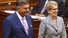 Ontario Finance Minister Charles Sousa (L) arrives with Ontario Premier Kathleen Wynne to deliver the provincial budget at Queens Park in Toronto, July 14, 2014. REUTERS/Mark Blinch (CANADA - Tags: POLITICS) (MARK BLINCH/REUTERS)