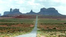 Highway 163 snakes through Monument Valley, Ariz. (JAKE BACON/Associated Press)