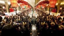 """Bargain hunters shop for discounted merchandise at Macy's on """"Black Friday,"""" Nov. 25, 2011 in New York City. (Michael Nagle/Getty Images/Michael Nagle/Getty Images)"""