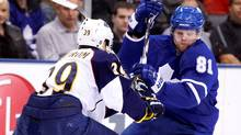 Toronto Maple Leafs forward Phil Kessel tries to get past Atlanta Thrashers defenseman Tobias Enstrom during the second period of their game in Toronto on March 30, 2010. (MIKE CASSESE/MIKE CASSESE/REUTERS)