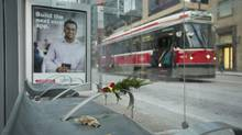 A make-shift memorial sits at a TTC stop where a man was found without vital signs in Toronto on Tuesday. (Kevin Van Paassen for The Globe and Mail)