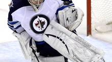 Winnipeg Jets' Ondrej Pavelec makes a save against the Florida Panthers during the second period of their NHL hockey game in Sunrise, Florida March 8, 2013. (RHONA WISE/REUTERS)