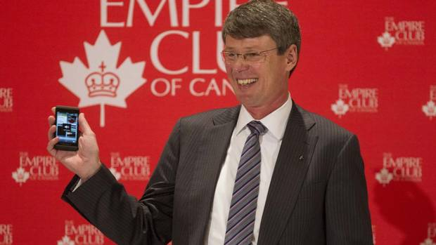 """Research In Motion Ltd. CEO Thorsten Heins holds a new BlackBerry device as he speaks to guests at the Empire Club of Canada luncheon in Toronto on Feb. 5, 2013. """"It is an exciting day for BlackBerry and for Canada,"""" Mr. Heins said. (Chris Young/The Canadian Press)"""