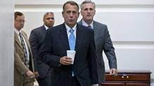 Speaker of the House John Boehner, R-Ohio, with House Majority Whip Kevin McCarthy, R-Calif., right, walks to a meeting of House Republicans at the Capitol in Washington, Tuesday, Oct. 15, 2013, as a partial government shutdown enters its third week. (J. Scott Applewhite/AP Photo)