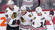 Chicago Blackhawks' Ryan Garbutt, centre, celebrates his goal against the Montreal Canadiens with teammates Dennis Rasmussen, left, and Richard Panik during a game against the Canadiens on Thursday, January 14, 2016 in Montreal. (Paul Chiasson/THE CANADIAN PRESS)