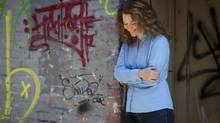 Novelist Billie Livingstonin Vancouver's down town Eastside July 25, 2012. (John Lehmann/The Globe and Mail)