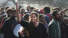 An Indian girl shouts during a protest in New Delhi, India, Monday, Dec. 31, 2012. The gang-rape and killing of a New Delhi student has set off an impassioned debate about what India needs to do to prevent such a tragedy from happening again. The country remained in mourning Monday, two days after the 23-year-old physiotherapy student died from her internal wounds in a Singapore hospital. AP Photo/Manish Swarup) (Manish Swarup/AP)