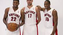 Left to right: Toronto Raptors Rudy Gay, Jonas Valanciunas and DeMar DeRozan on the team's media day on Sept. 30, 2013. BMO announced a multi-year sponsorship deal with the team on Oct. 29, 2013. (Frank Gunn/The Canadian Press)