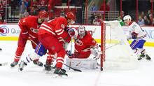 Carolina Hurricanes goalie Cam Ward (30) Carolina Hurricanes defensemen Ron Hainsey (65) makes a save against Montreal Canadiens forward David Desharnais (51) during the third period at PNC Arena in Raleigh, NC on Nov. 18, 2016. The Hurricanes won 3-2. (James Guillory/USA Today Sports)