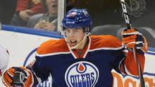 Edmonton Oilers' Ryan Nugent-Hopkins celebrates his goal against the Calgary Flames during third period NHL action in Edmonton on December 3, 2011. (John Ulan/THE CANADIAN PRESS)
