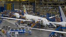 Boeing 787s sit at the company's assembly plant in Everett, Wash. (John Froschauer/AP)
