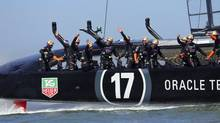 Oracle Team USA celebrates after winning a race to tie Emirates Team New Zealand in San Francisco at the America's Cup