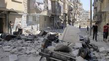 Damaged buildings and vehicles are seen after shelling by forces loyal to President Bashar al-Assad in Aleppo's district of Bustan Al Qasr, Aug. 7, 2012. (Obeida Al Naimi/REUTERS)