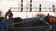 Emergency personnel attend to a VIA Rail passenger train that derailed in Burlington Ontario, February 26, 2012. (STRINGER/Matthew Sherwood/Reuters)