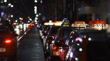 Taxis line up on King St. West outside First Canadian Place in downtown Toronto on March 12 2013. (Fred Lum/The Globe and Mail)