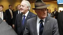 More than 85 per cent of Barrick's shareholders opposed multimillion-dollar payments to company founder Peter Munk, front, director Brian Mulroney, and the company's new vice-chairman. (Fernando Morales/The Globe and Mail)