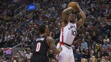 Toronto Raptors' DeMar DeRozan (10) shoots on Portland Trail Blazers' Damian Lillard during the first half of the NBA basketball action in Toronto on Friday March 4, 2016. (Chris Young/THE CANADIAN PRESS)