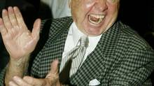 Academy Award winning actor Mickey Rooney applauds at a press conference October 29, 2002, announcing plans for The Motion Picture Hall of Fame in Hollywood. The new attraction will feature exhibits and multimedia attrractions about the world of Hollywood films and is expected to open in early 2004. (FRED PROUSER/REUTERS)