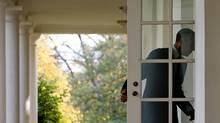 U.S. President Barack Obama walks into the cabinet room at the White House on Tuesday, November 3, 2009. (SAUL LOEB)