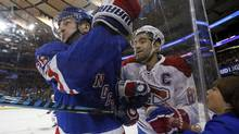 Montreal Canadiens captain Max Pacioretty is checked by New York Rangers forward Jimmy Vesey during Game 4 of the teams' first-round playoff series on Tuesday, April 18, 2017. (Adam Hunger/USA Today Sports)