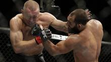 Johny Hendricks, right, exchanges punches with Georges St. Pierre, of Canada, during a UFC 167 mixed martial arts championship welterweight bout on Saturday, Nov. 16, 2013, in Las Vegas. St. Pierre won by split decision. (Isaac Brekken/AP)
