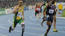 South Africa's Oscar Pistorius (L) competes in the men's 400 metres semi-finals at the International Association of Athletics Federations World Championships in Daegu on August 29, 2011. (PETER PARKS/AFP/Getty Images)