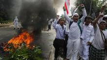 The film Innocence of Muslims has provoked a wave of deadly anti-American protests from the Middle East to Jakarta, above. (Dita Alangkara/AP)