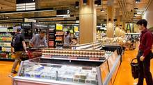 People shop at the Loblaws at Maple Leaf Gardens in Toronto. (Matthew Sherwood For The Globe and Mail)