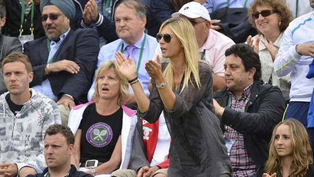 Russian tennis great Maria Sharapova celebrates her boyfriend Grigor Dimitrov's (impending) gritty victory over Grega Zemlja of Slovenia at Wimbledon. (TOBY MELVILLE/REUTERS)