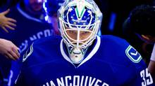 Vancouver Canucks' goalie Cory Schneider leads the team out for the pre-game skate prior to playing the Los Angeles Kings in game 5 of an NHL Western Conference quarterfinal Stanley Cup series in Vancouver, B.C., on Sunday April 22, 2012. (DARRYL DYCK/THE CANADIAN PRESS)