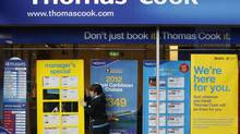 A worker changes the window display of Thomas Cook in Loughborough, central England December 14, 2011. (DARREN STAPLES/REUTERS)