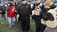 Philadelphia Eagles head coach Andy Reid (C) walks on the field after losing to the Washington Redskins in their NFL game in Philadelphia, Pennsylvania, December 23, 2012. (TIM SHAFFER/REUTERS)