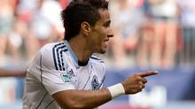 Vancouver Whitecaps' Camilo Sanvezzo, of Brazil, celebrates his second goal against the Chicago Fire during the second half of an MLS soccer game in Vancouver, B.C., on Sunday July 14, 2013. (DARRYL DYCK/THE CANADIAN PRESS)