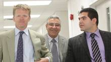 Bob Nazarian (centre), owner of the ill-fated Algo Centre Mall, leaves the inquiry into the mall's collapse with his son Levon (right) and lawyer Derek Fulton on Wednesday, July 24, 2013, in Elliot Lake, Ont. (Colin Perkel/THE CANADIAN PRESS)