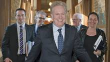 Flanked by his staff, Quebec Premier Jean Charest walks to Question Period at the National Assembly on Feb. 15, 2011. (Jacques Boissinot/THE CANADIAN PRESS)